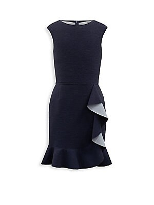 Image of Adorable crinkle dress with reverse frill detailing Roundneck Cap sleeves Concealed back zip Polyester Hand wash Made in UK. Children's Wear - Classic Children. David Charles. Color: Navy. Size: 7.