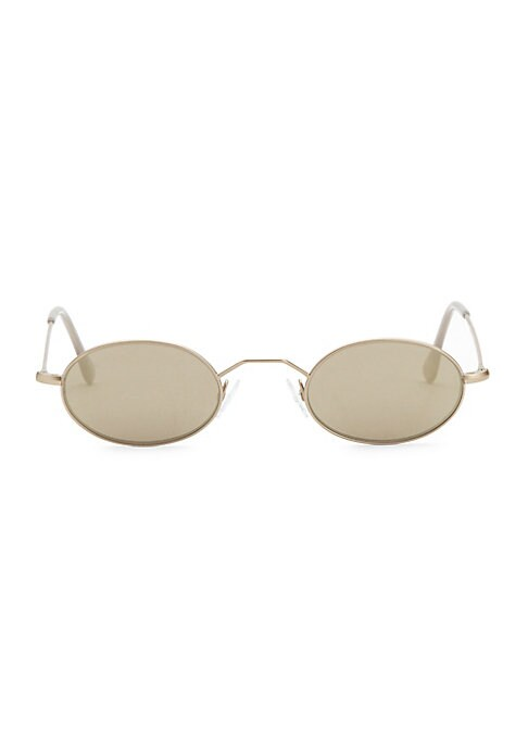Image of Tinted oval lenses with striking goldtone frame.44mm lens width; 24mm bridge width; 139mm temple length. Tinted green lenses. Metal. Imported.