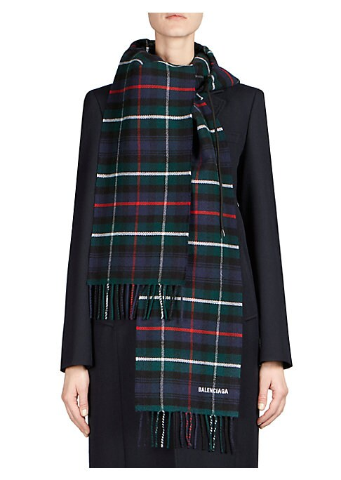 Image of A drawstring hood meets the scarf in this smart mash-up from designer Demna Gvasalia. The piece is executed in a preppy plaid fabric with fringed hems, which makes the design coming from the streetwear designer that much cheekier. Attached hood. Wool. Dry