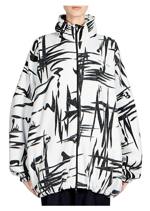 Image of An abstract print with an illustrative feel provides a strong visual statement in this 90s-inspired fleece jacket. Un-zip the collar to reveal a tomato red windbreaker hood, a telltale sign of designer Demna Gvasalia's hand. Stand collar with attached hoo