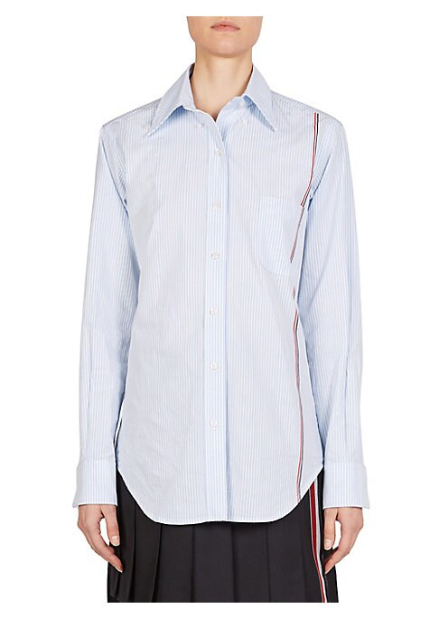 Image of A modern take on a wardrobe staple, this cotton pinstripe button-down is accented with the brand's signature striping at the side. Cut with an oversize fit, this blouse is the perfect tucked in-or-out layering piece. Point collar. Long sleeves. Button fro