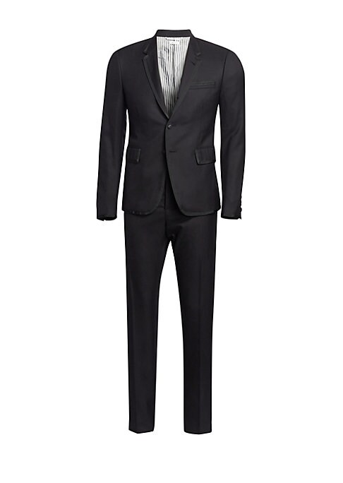 Image of Twill wool tuxedo framed by grosgrain trim and featuring a high armhole jacket and low-rise skinny trousers. Super 120s wool. Dry clean. Made in Italy. JACKET. Notch lapels with buttonhole. Long sleeves. High armholes. Buttoned cuffs. Two- button single b