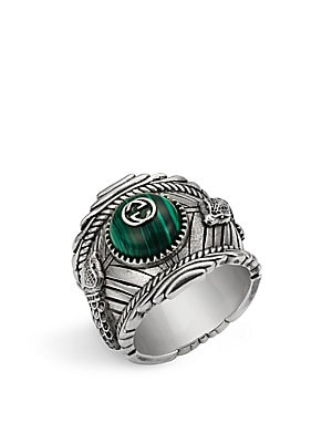 Image of Intricately carved pendant ring complete with center stone and logo detail Sterling silver with aged finish Made in Italy. Men Accessories - Jewelry. Gucci. Color: Silver. Size: 7.5.