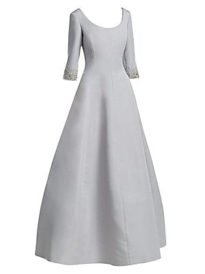 Image of This structural gown features refined craftsmanship through its exposed seams. Embellished with beads at the sleeves, this is a subtly ornate piece. Scoopneck Elbow-length sleeves Concealed back zip Matte finish Silk Dry clean Made in Canada SIZE & FIT Fi