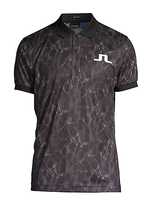 """Image of Sporty casual polo shirt works at the office and beyond. Polo collar. Short sleeves. Three-button front. Pullover style. About 27"""" from shoulder to hem. Polyester. Machine wash. Imported."""