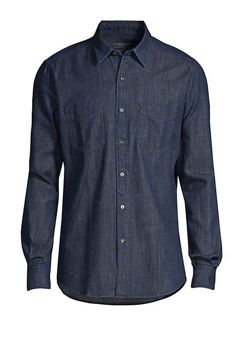 """Image of Classic long sleeve denim button down crafted of comfortable cotton. Point collar. Long sleeves. Button front. Button cuffs. Chest patch pockets. Shirttail hem. Cotton. Dry clean. Made in Italy. SIZE & FIT. Contemporary fit. About 28"""" from shoulder to hem"""