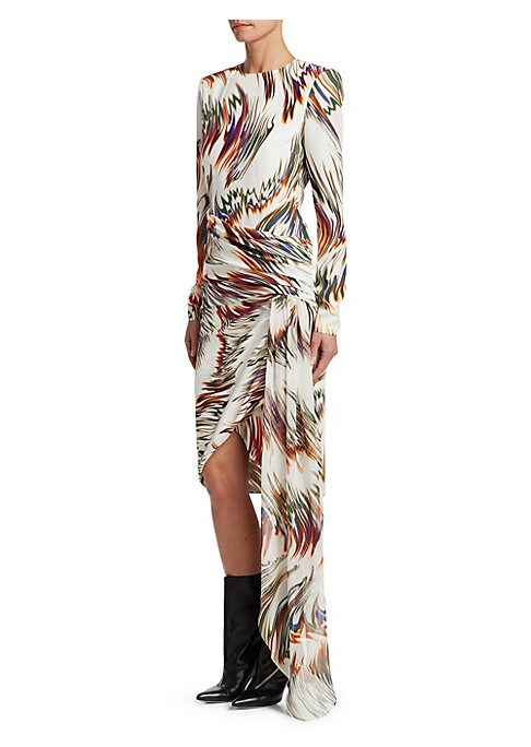 Image of Hubert de Givenchy founded his namesake fashion house specializing in Haute Couture in 1952 and today, the house is synonymous with aristocratic elegance and style. This beautiful long sleeve printed gown is constructed of wrapped silk with a split hem an