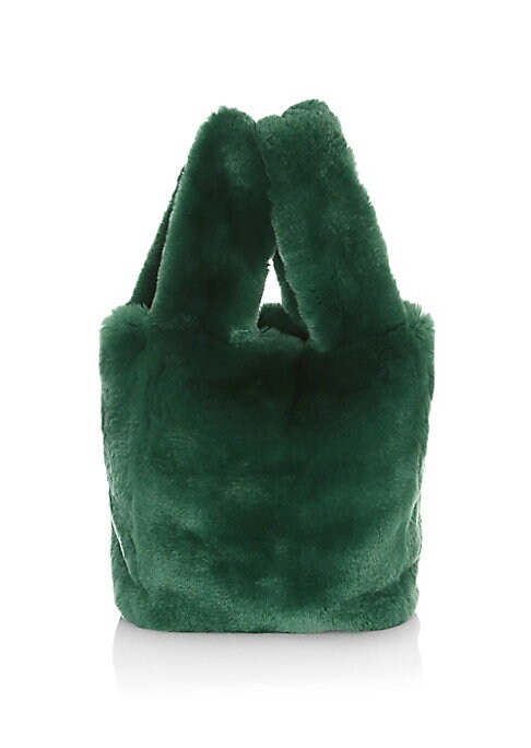 "Image of Cuddly tote bag crafted out of rabbit fur for a playful silhouette. Open top. Two inside slip pockets. Lined. Fur type: Dyed rabbit. Fur origin: China. Dry clean by fur specialist. Imported. SIZE. Dual top handles, 7"" drop.9""W x 10""H x 3""D."
