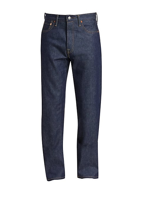"""Image of '90s-inspired essential jeans constructed of a heavyweight rigid cotton. Five-pocket style. Zip fly with button closure. Cotton. Dry clean. Made in Italy. SIZE & FIT. Rise, about 12.5"""".Inseam, about 33"""".Leg opening, about 16""""."""