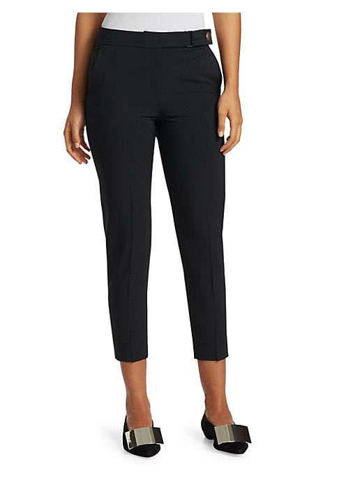 Image of The cigarette pant is revisited in this chic iteration boasting crisp pleating and an eyecatching snap button closure at the waist. These cropped trousers are crafted from a stretch fabric, making for a comfortable fit. Banded waist. Zip fly with snap clo