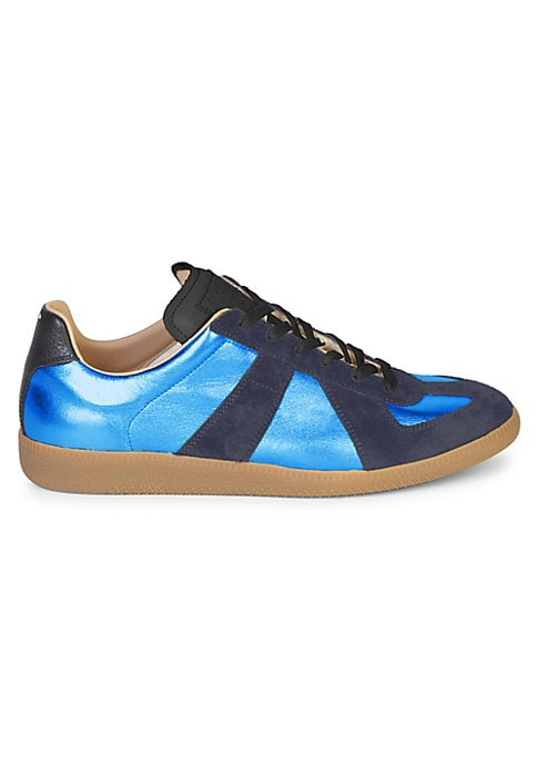 Image of Statement making sneaker with metallic panelling. Leather upper. Leather and textile lining. Rubber sole. Made in Italy.