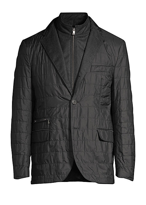 Image of A modern outerwear look, this sartorial blazer is finished with a quilted feel. Winged lapels. Long sleeves. Front button close. Chest slip pocket. Side zip pocket. Waist flap pockets. Button cuffs. Polyester. Dry clean. Made in Italy. SIZE & FIT. Tailore