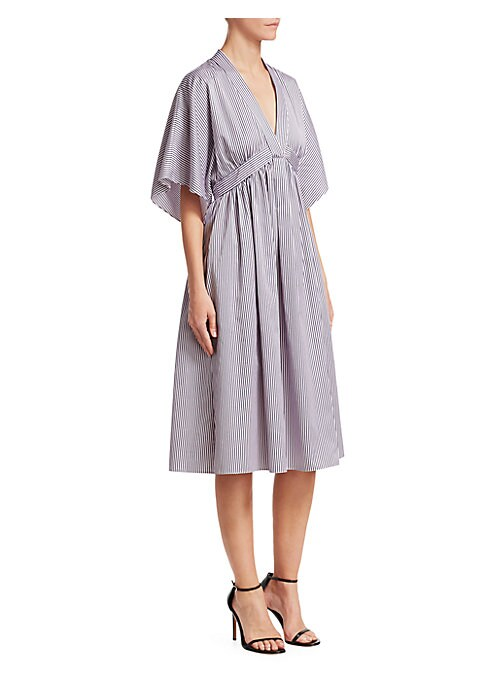 Image of Cut from lightweight cotton poplin, this striped midi dress is designed with an empire waist, creating an effortless A-line silhouette.V-neck. Short sleeves. Concealed back zip closure. Cotton. Dry clean. Made in USA of Italian fabric. SIZE & FIT. About 4