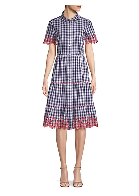 "Image of A tiered skirt and eyelet detailing elevate this on-trend gingham dress. Point collar. Short flare sleeves. Button front. Banded waist. About 43.5"" from shoulder to hem. Cotton. Machine wash. Imported. Model shown is 5'10"" (177cm) and wearing US size 4."