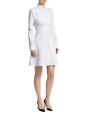 Image of An update on the classic shirtdress, this iteration flaunts a mirror pleated waist that flatteringly draws the eye with texture and shape. Finished with a waffle texture, its lightweight cotton construction makes it the perfect summery look. Buttoned poin