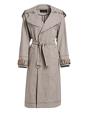 Image of A modern staple, this trenchcoat features menswear-inspired styling and an understated check print. Cut in a relaxed slouchy silhouette, this topper adds an instant dose of classic elegance to any look. Notch lapel Long sleeves Self-tie belt Epaulets Adju