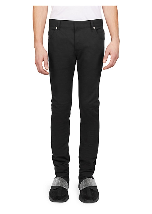 """Image of A matte finish adds low key rockstar appeal to these to these cotton jeans. Belt loops. Zip fly with hook closure. Five-pocket style. Cotton. Machine wash. Made in Italy. SIZE & FIT. Rise, about 11"""".Inseam, about 30"""".Leg opening, about 12""""."""