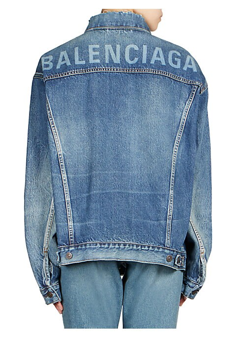 Image of Featuring faded logo text from shoulder-to-shoulder, this jacket borrows from the boys in a perfectly oversized, overworn fit. Spread collar. Long sleeves. Button cuffs. Button front. Chest button flap pockets. Waist welt pockets. Button-tab hem. Ripped d