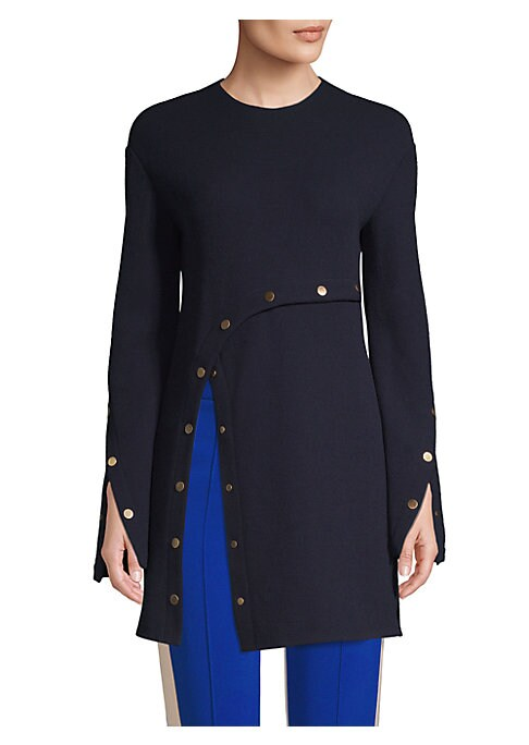 Image of This flattering crepe tunic flaunts an un-buttoned slit accent and vented cuffs. Its navy blue finish contrasts timelessly with goldtone studding for an elevated, modern look. Roundneck. Long sleeves. Concealed back zip. Vented cuffs. Side slit. Crepe fin