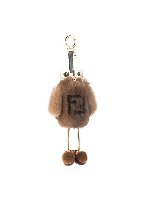 Image of Chic logo charm made from plush mink and fox fur. Goldtone. Fur/leather/metal. Fur type 1: Dyed mink fur. Fur origin 1: Denmark and Finland. Fur type 2: Marble Arctic Frost fox natural fur. Fur origin 2: Finland. Lobster clasp. Made in Italy. SIZE. Length
