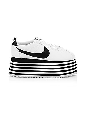 """Image of Classic sneakers get a chic update with this tiered platform design. Leather upper Round toe Lace-up vamp Leather lining Rubber sole Imported SIZE Platform height, 3"""" (75mm). Women's Shoes - Designer Womens Shoes > Saks Fifth Avenue. Comme des Garcons. Co"""