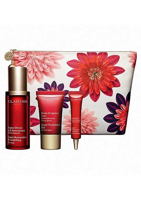 Image of $216 VALUE. WHAT IT IS. Limited-edition Clarins' best-selling franchise zeros-in on wrinkles, age spots and loss of firmness - giving a visible lift to skin weakened by the natural aging process. Comes in a travel-friendly floral pouch. Made in France. TH