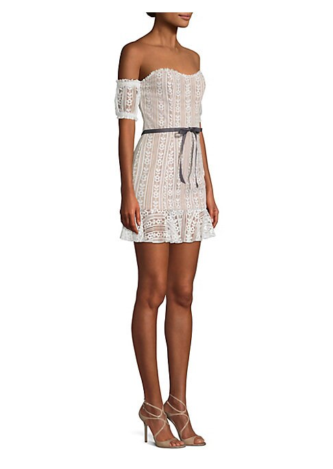 """Image of Flirty lace mini flaunts a bardot finish and flounce hem. Sweetheart neckline. Off-the-shoulder silhouette. Short sleeves. Pullover style. Bow waist. Flounce hem. Lined. About 32"""" from shoulder to hem. Polyester/spandex. Dry clean. Imported. Model shown i"""