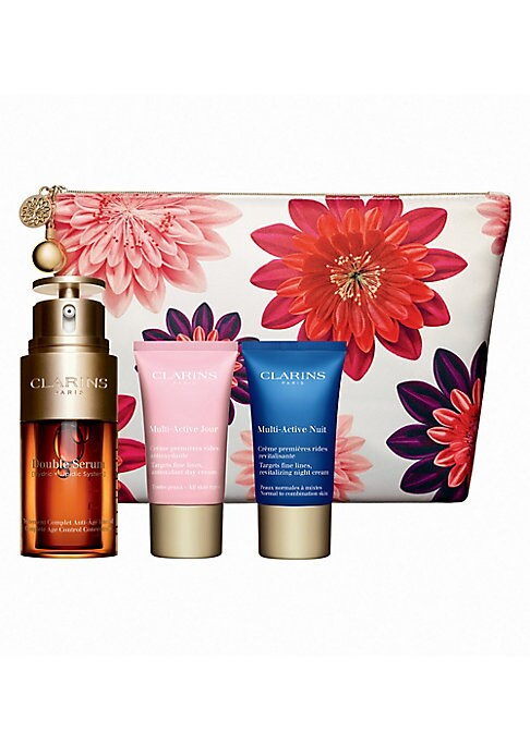 Image of $123 VALUE. WHAT IT IS. Limited-edition Discover Double Serum - our number 1 selling serum. Partner with Multi-Active Day and Night Creams to fight fine lines and the effects of daytime stress for glowing results. Comes in a travel-friendly floral pouch.