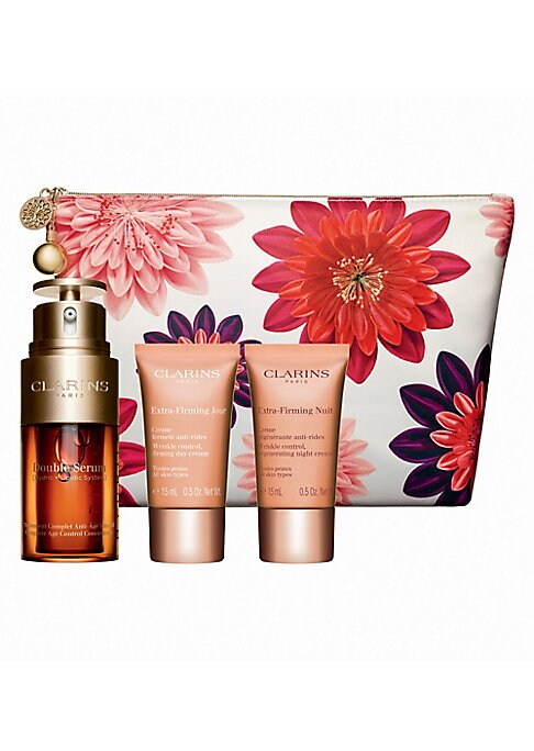 Image of $142 VALUE. WHAT IT IS. Limited-edition Discover Double Serum - our number 1 selling serum. Partner with Extra-Firming Day and Night Creams to visibly lift and minimize the look of wrinkles for unprecedented results. Comes in a travel-friendly floral pouc