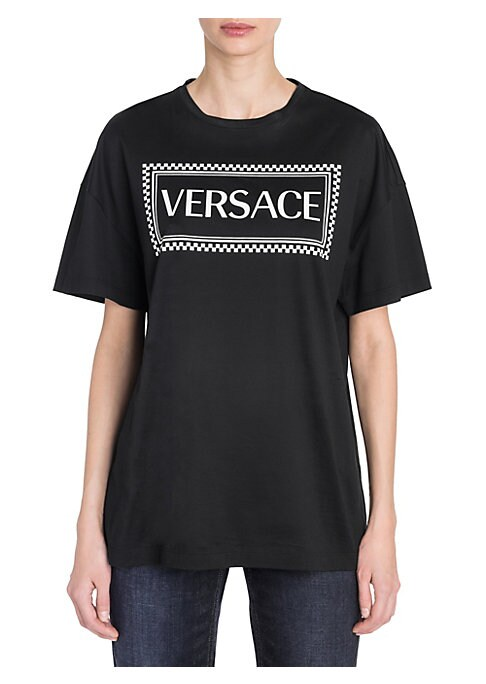 """Image of Short sleeve t-shirt in cool cotton shows your Versace style. Bold front logo elevates the classic silhouette. Roundneck. Short sleeves. Pull-on style. Cotton. Dry clean. Made in Italy. SIZE & FIT. About 18"""" from shoulder to hem. Model shown is 5'10"""" (177"""