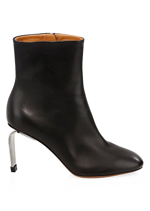 "Image of Leather ankle boots with a unique curved metal heel. Leather upper. Round toe. Inside zip closure. Leather lining. Lightly padded insole. leather outsole. Made in Italy. SIZE. Curved rectangular heel, 3.25"".Shaft, 8.5"".Leg circumference, 9.5""."