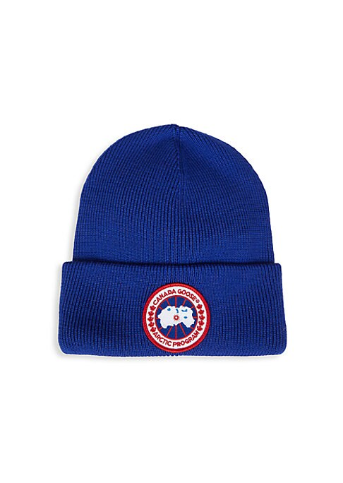 """Image of Knit beanie flaunts an iconic embroidered logo patch. Wool. Dry clean. Made in Italy. SIZE. Brim width, 8.5""""."""