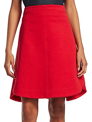 "Image of Classic cotton A-line skirt in a flattering flared silhouette Concealed back zip About 22"" long Lined Cotton/acrylic/polyester Dry clean Imported Model shown is 5'10"" (177cm) wearing US size 4. Contemporary Sp - Workshop. Carven. Color: Espelette. Size: 3"