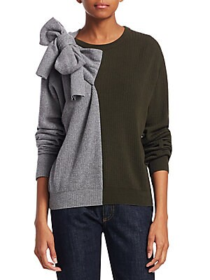 "Image of Color block sweater with statement bow detail Roundneck with bow detail on shoulder Long sleeves Pullover style Ribbed cuffs and hem About 23 from shoulder to hem Merino wool/cashmere Dry clean Made in Spain Model shown is 5'10"" (177cm) wearing US size Sm"
