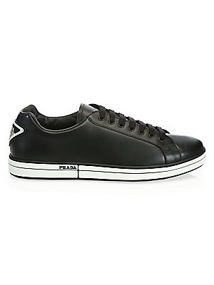 Image of Bright low-tops with contrast trim and patch logo accents Leather upper Round toe Lace-up vamp Side logo detail Back patch logo detail Rubber sole Made in Italy. Men's Shoes - Prada Mens Footwear. Prada. Color: Black. Size: 12 UK (13 US).