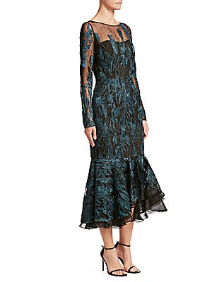 """Image of An illusion neckline and fishtail hems elevate this embroidered cocktail dress Boatneck Long sleeves Concealed back zip closure Asymmetrical ruffle hems Lined About 51"""" from shoulder to hem Nylon Dry clean Imported Model shown is 5'10 (177cm) wearing US s"""