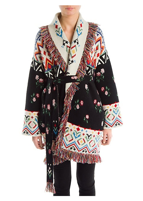 Image of From the Saks IT LIST. PUTTING ON THE KNITS. That favorite-sweater feeling goes from head to toe. Bohemian prints merge with delicate florals on this stunning cashmere cardigan. Framed with colorful fringes, this is a truly artful piece. Shawl collar. Lon
