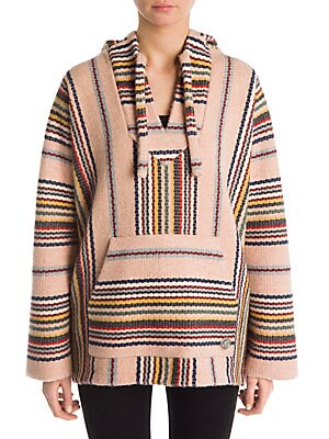 Image of From the Saks IT LIST PUTTING ON THE KNITS That favorite-sweater feeling goes from head to toe. This artisanal piece is woven into multicolor stripes and an athletic silhouette. Baggy in its look, this luscious essential is made for bohemian styling. Atta