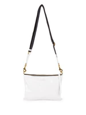 Isabel Marant crossbody shopper bag in distressed top-grain leather.  Removable, adjustable web shoulder strap. Zip top closure with tassel pull. 66b15d0beb