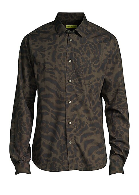 """Image of Leopard print shirt crafted from Italian cotton. Spreadcollar. Long sleeves. Button cuffs. Button closure. About 26"""" from shoulder to hem. Cotton. Dry clean. Made in Italy. Model shown is 5'10"""" (177cm) wearing US size Small."""