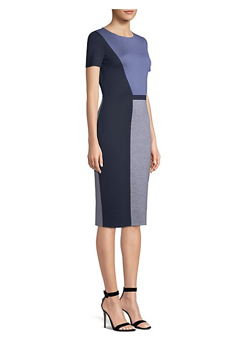 Image of Cut to the knee with a nipped-waist silhouette, this knit dress is a sophisticated staple. Large-scale mod colorblock print adds eye-catching detail. Roundneck. Short sleeves. Concealed back zip with hook and eye closure. Wool/rayon. Dry clean. Imported o