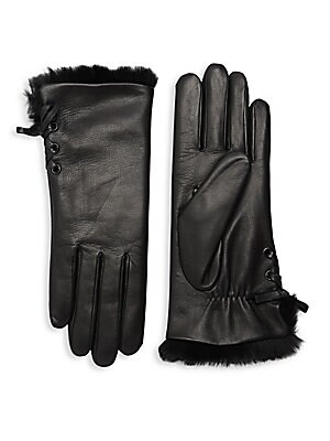 """Image of Supple lambskin leather gloves with cozy fur lining and lace-up side detail. Lambskin leather Fur type: dyed rabbit Fur origin: Spain Dry clean by a leather specialist Imported SIZE 10"""" long. Soft Accessorie - Womens Gloves > Saks Fifth Avenue. Agnelle. C"""