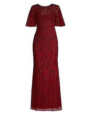 """Image of Alluring illusion neckline adds sensuality to this 1920s-style embellished gown Roundneck Flutter sleeves Concealed back zip and hook-and-eye closure Lined About 59 from shoulder to hem Polyester Spot clean Imported Model shown is 5'10"""" (177cm) wearing a"""