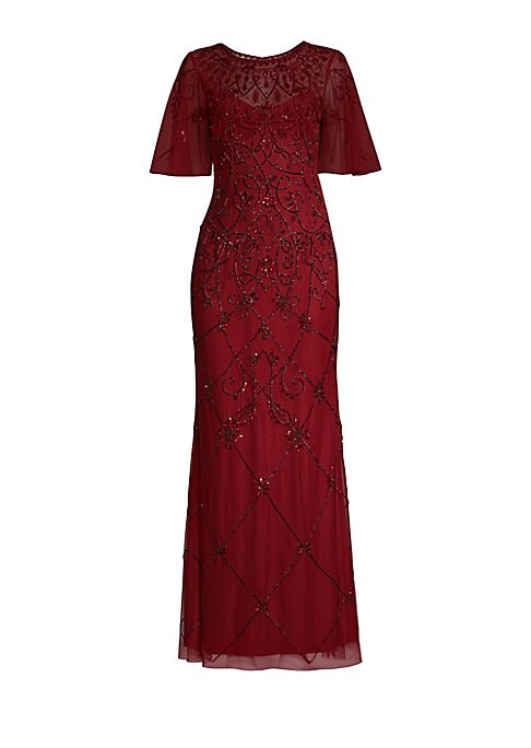 """Image of Alluring illusion neckline adds sensuality to this 1920s-style embellished gown. Roundneck. Flutter sleeves. Concealed back zip and hook-and-eye closure. Lined. About 59"""" from shoulder to hem. Polyester. Spot clean. Imported. Model shown is 5'10"""" (177cm)"""
