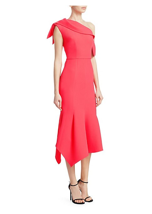 Image of Cut with an elegant one-shoulder design and flatteringly tailored, this bright pink midi is a must-have summer occasion look. We love its flowy asymmetric flared hem and regal sash-like neckline paired with elegant accessories to really let it shine. One-