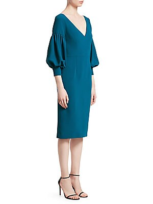"""Image of Puff sleeves add a vintage feel to this flattering sheath V-neck Three-quarter length puff sleeves Concealed back zip close Drop shoulders Button cuffs Front darted seams Back vented hem About 45"""" from shoulder to hem Polyester Dry clean Imported Model sh"""