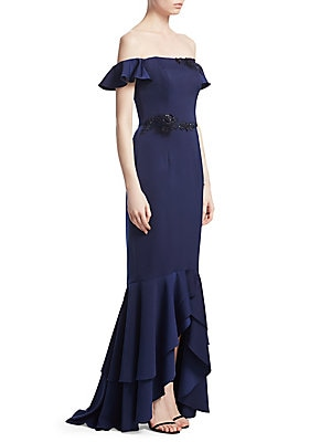 """Image of Elegant ruffle-tiered mermaid gown flaunts embellished accents Off-the-shoulder neckline Short ruffle sleeves Concealed back zip Embellished waist and neckline accents Tiered ruffle hi-lo mermaid hem Lined About 61"""" from shoulder to hem Polyester/acrylic"""