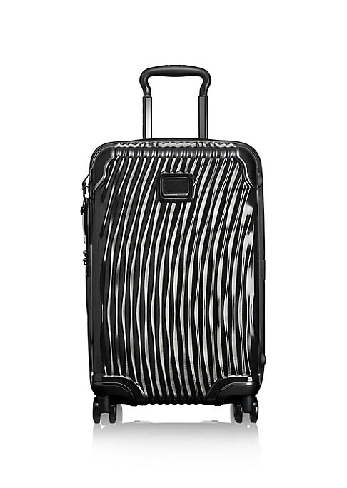 Image of Perfect for both international and domestic travel, the International Carry-On features a streamlined design and a brand-new wheel system that makes for smooth maneuvering. Three-stage telescoping top handle. Zip around closure. Exterior integrated TSA lo