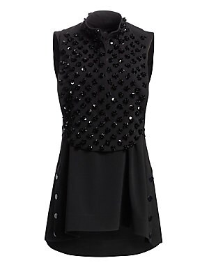 Image of A bib of shimmering sequins in a three-dimensional floral motif adorns this sleeveless tunic adding an eye-catching element to a simple garment. Cut in a tuxedo-inspired style with an adjustable back belt, it has a distinct menswear feel while remaining t