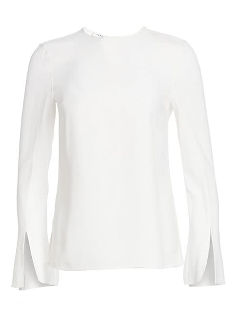 Image of A chic addition to your workwear wardrobe, this blouse has a relaxed lady-like feel. With minimal styling and a sleek finish it features elegant flared trumpet sleeves accented with double slits. Roundneck. Long trumpet sleeves with slits. Concealed back